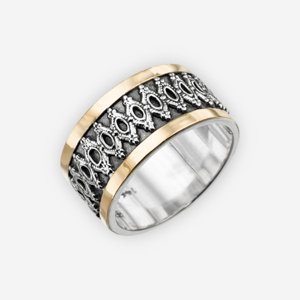 Ornate silver oxidized ring is made from 925 sterling silver and accented with two 14k gold bands.