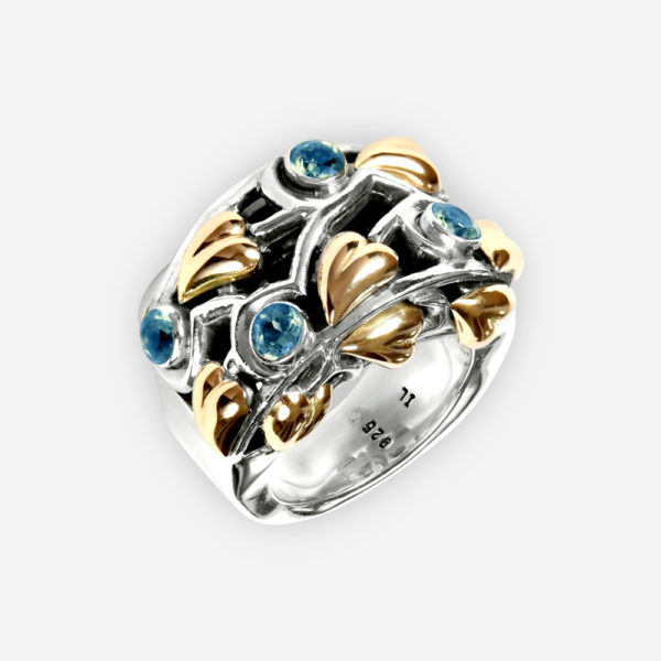 Ornate silver ring set with blue topaz and 14k gold leaf accents.