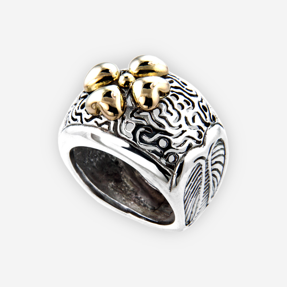 Ornate silver crafted crafted from 925 sterling silver with 14k gold flower detail.