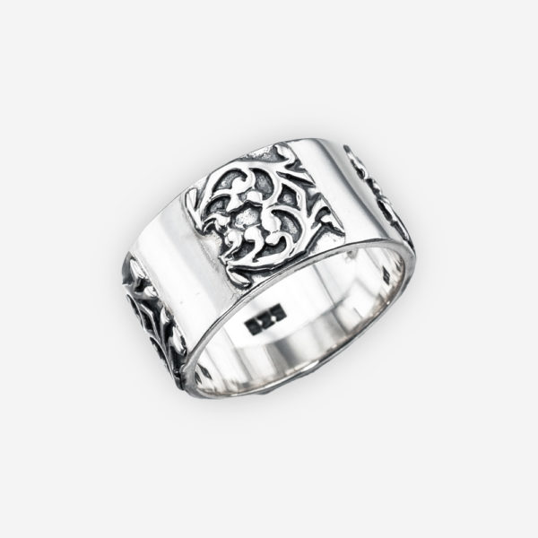 Ornate wide band sterling silver ring is crafted from oxidized 925 sterling silver with ornate embossed design.