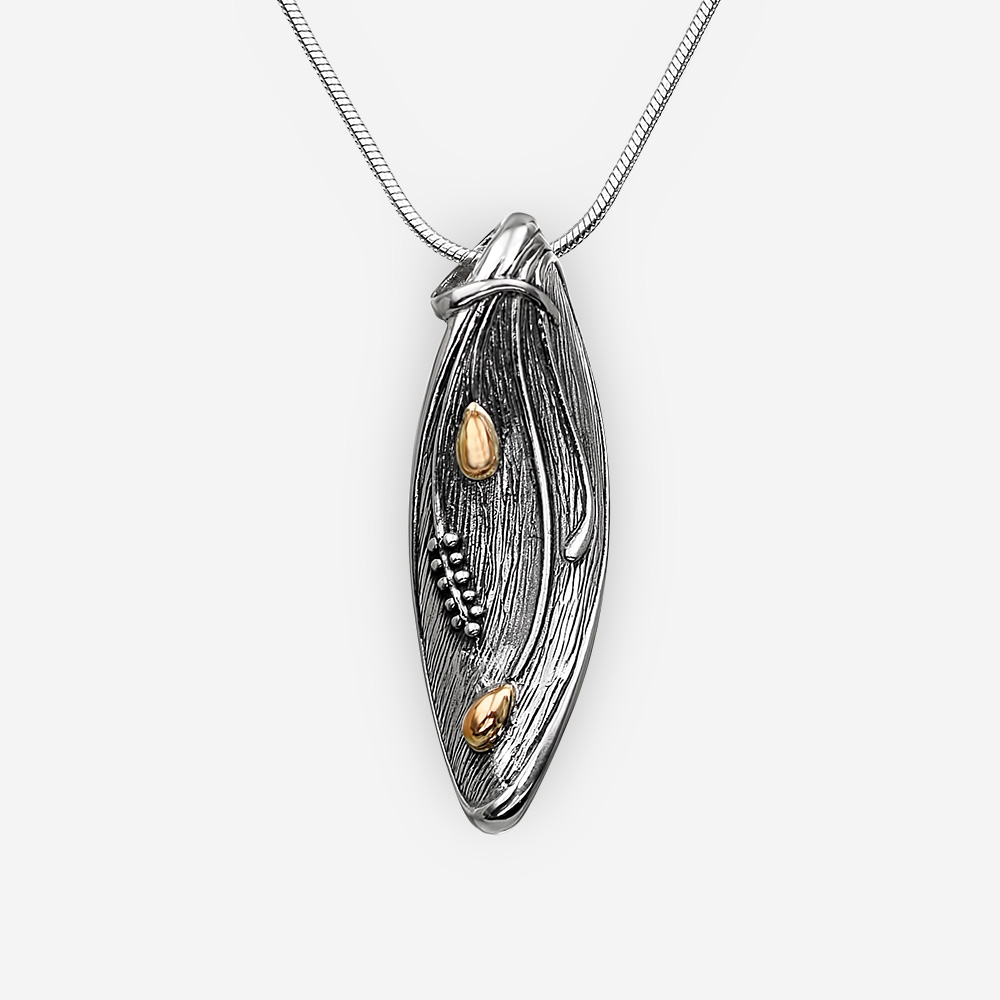 Oval silver pendant with embossed 14k gold spikelets.