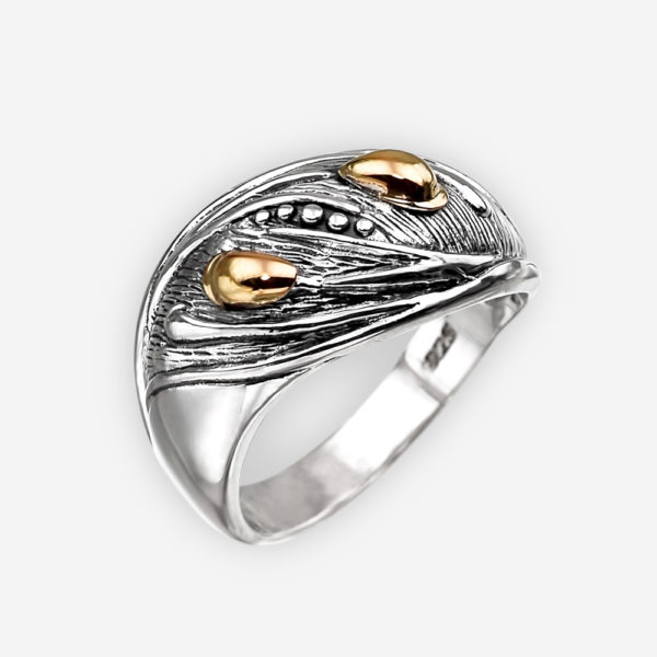 Oval silver ring with 14k gold embossed spikelets.