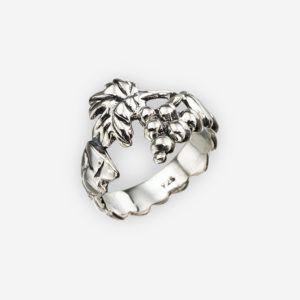 A beautiful oxidized silver grape cluster ring featuring an oxidized sculpted design of a grape vine and cluster of grapes crafted from sterling silver.