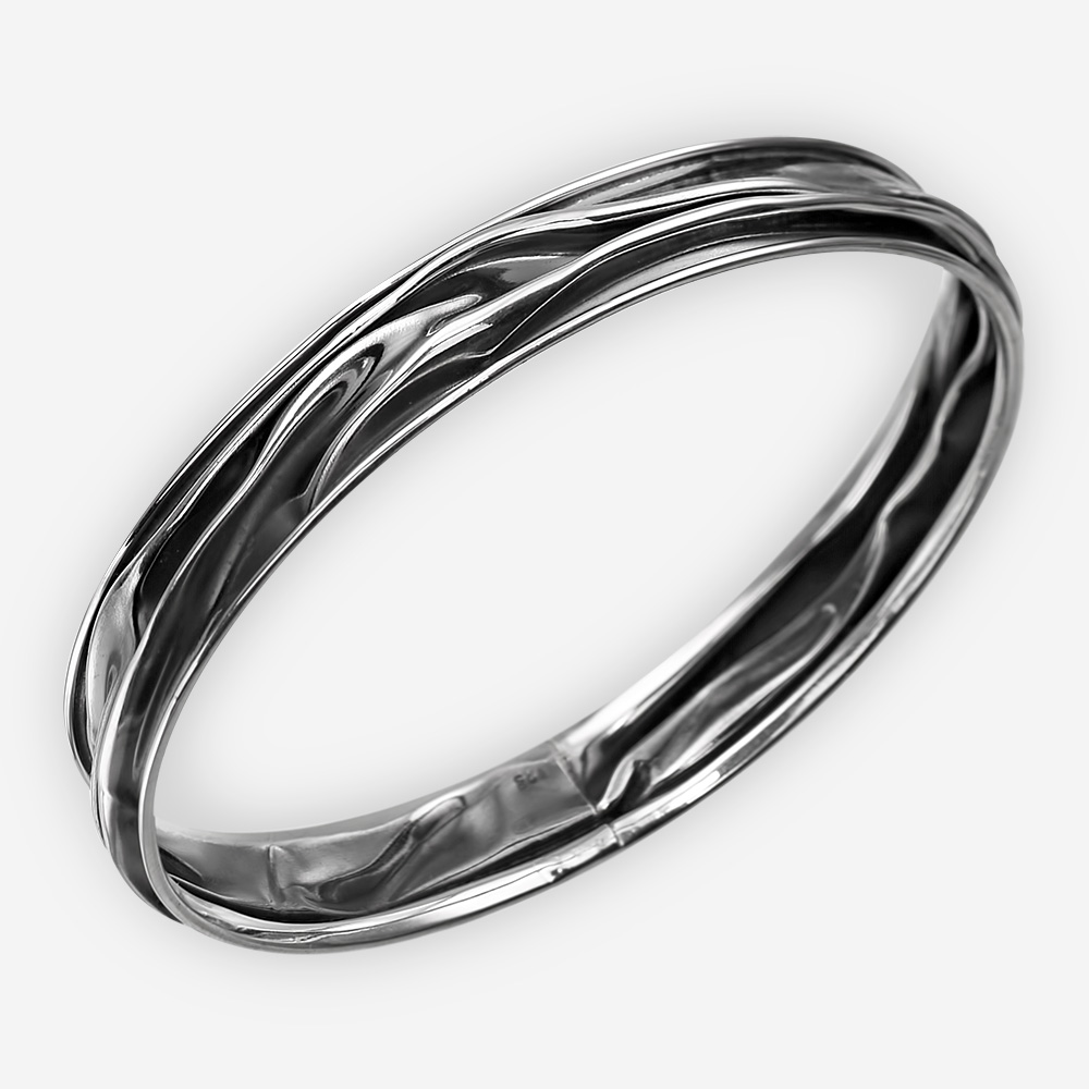 Oxidized silver sculpted bangle made from 925 sterling silver.