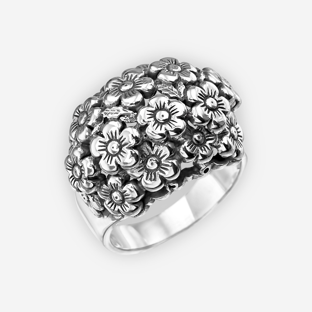 Oxidized sterling silver floral statement ring with a motif of a cluster of tiny flowers.