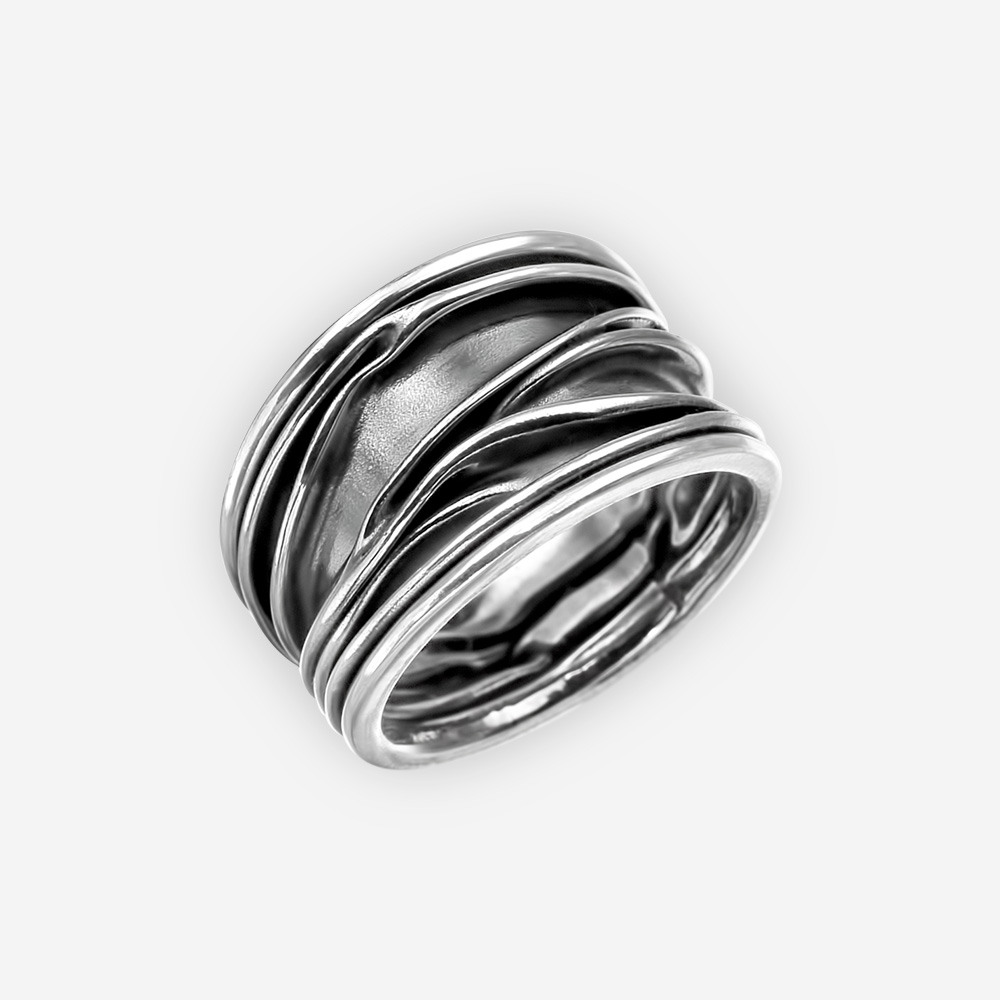 Oxidized sterling silver sculpted ring with a textured finish.