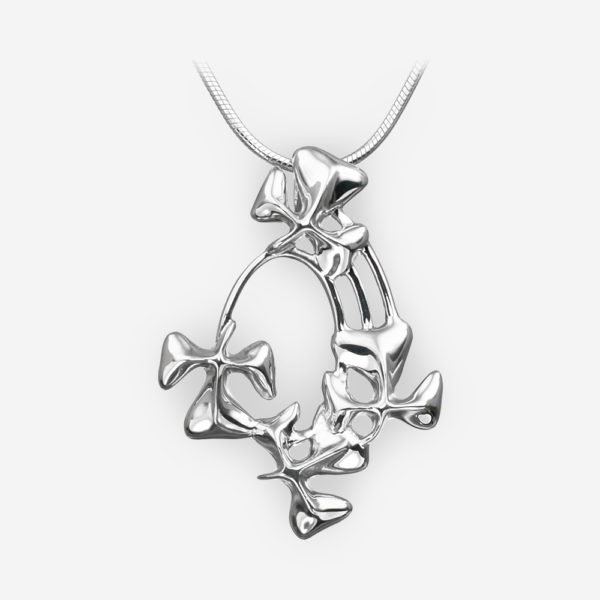 Polished sterling silver shamrock pendant with a high polished finish.