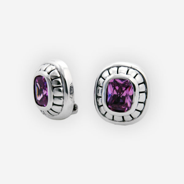 Pretty silver clip-on earrings are crafted from 925 sterling silver, are set with purple cubic zirconia stones and have clip-on backings.