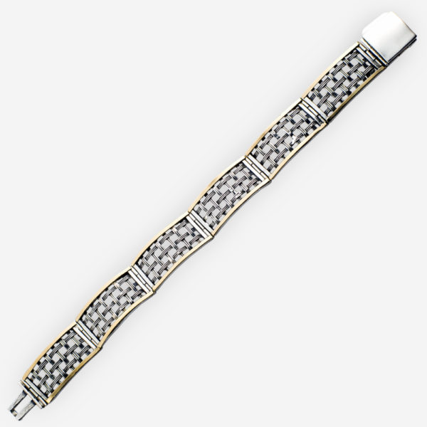 Rectangular silver lattice link bracelet with gold accents. 925 sterling silver and 14k gold.