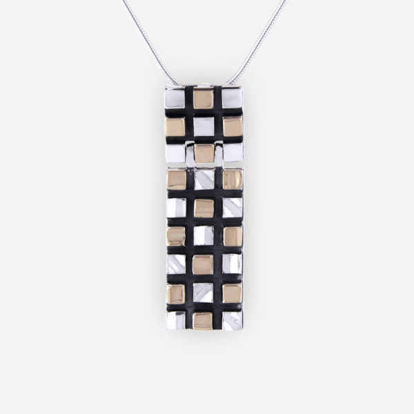 Rectangular two tone grid pendant crafted from 925 sterling silver and 14k gold.