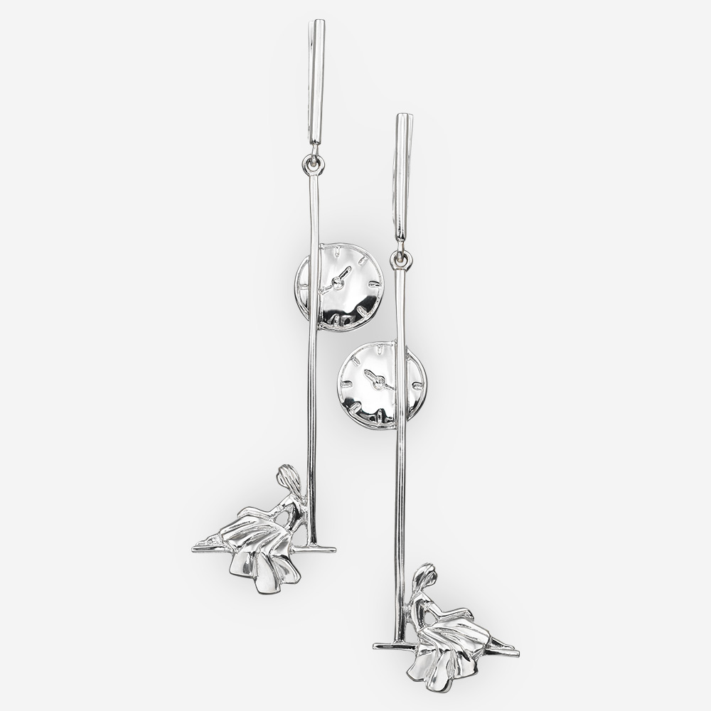 Romantic sterling silver long drop earrings depicting a girl sitting under a street clock.
