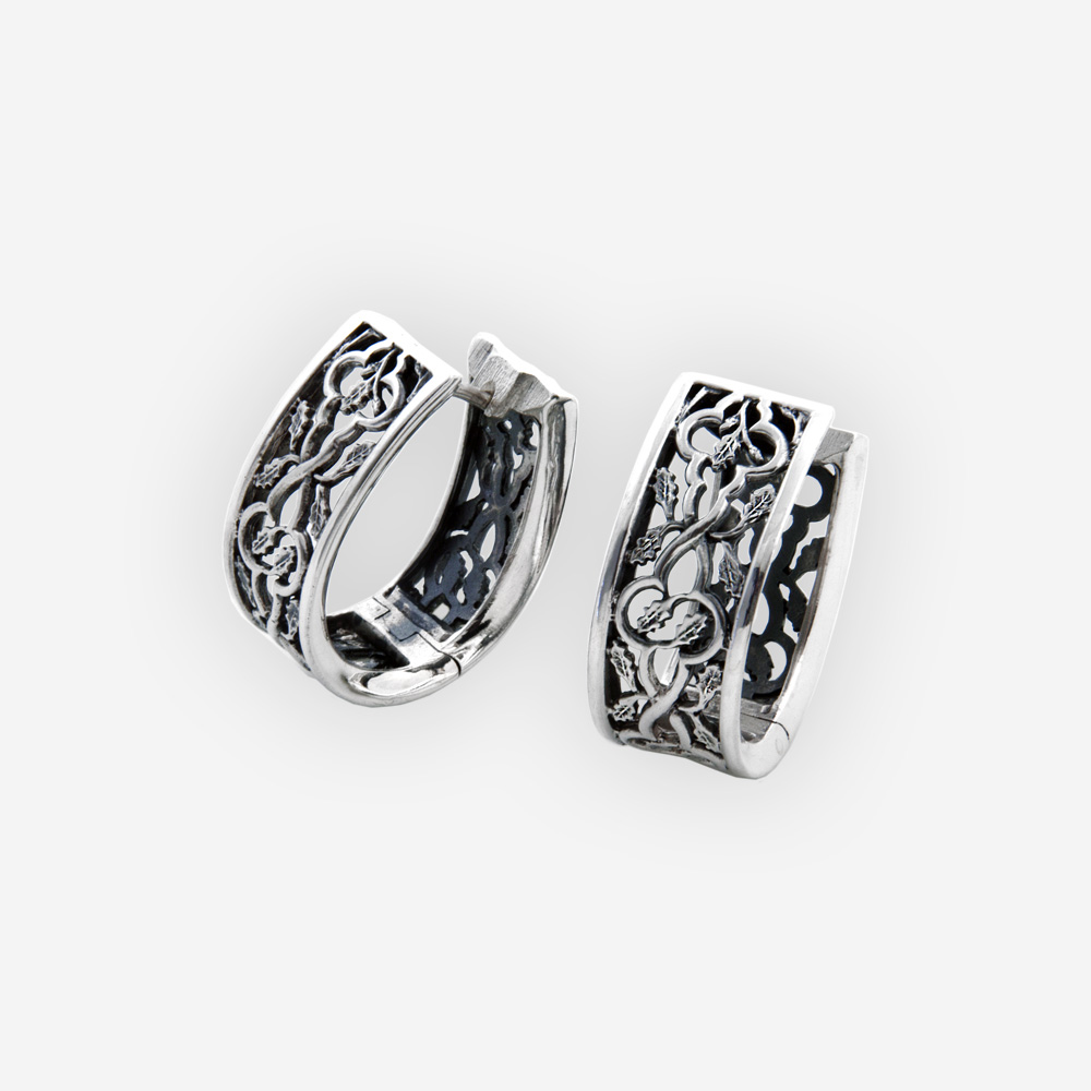 Scrolling leaves silver openwork hoops feature openwork scrolling leaves design, huggie closure, and crafted in 925 sterling silver.