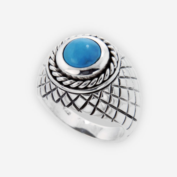 Sculptural Sterling Silver Ring setting with Turquoise and carved with snakeskin patterns.