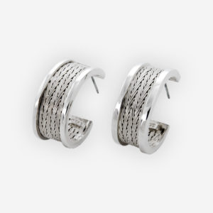 Semi-circle silver herringbone hoops crafted from 925 sterling silver and feature a handwoven herringbone pattern.