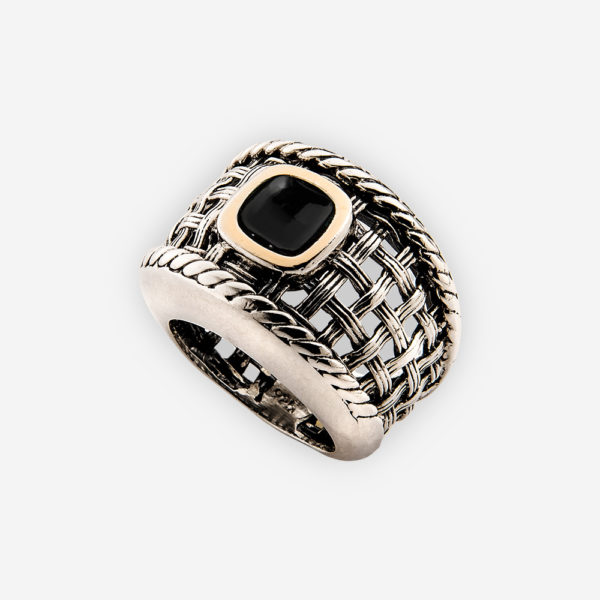 Silver onyx cocktail ring with oxidized silver lattice work and a single onyx cabochon set in a 14k gold bezel.