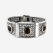 .Silver onyx bracelet with oxidized silver square lattice work links and onyx cabochons set in 14k gold bezels.