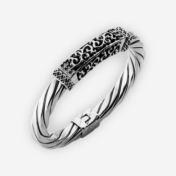 Thick silver cable bracelet with ornate openwork filigree centerpiece.