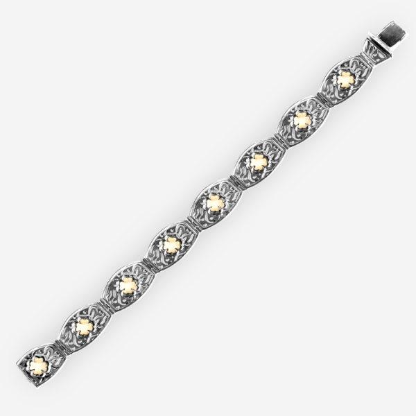 Silver clover bracelet with 14k gold shamrock clovers embossed on each link.