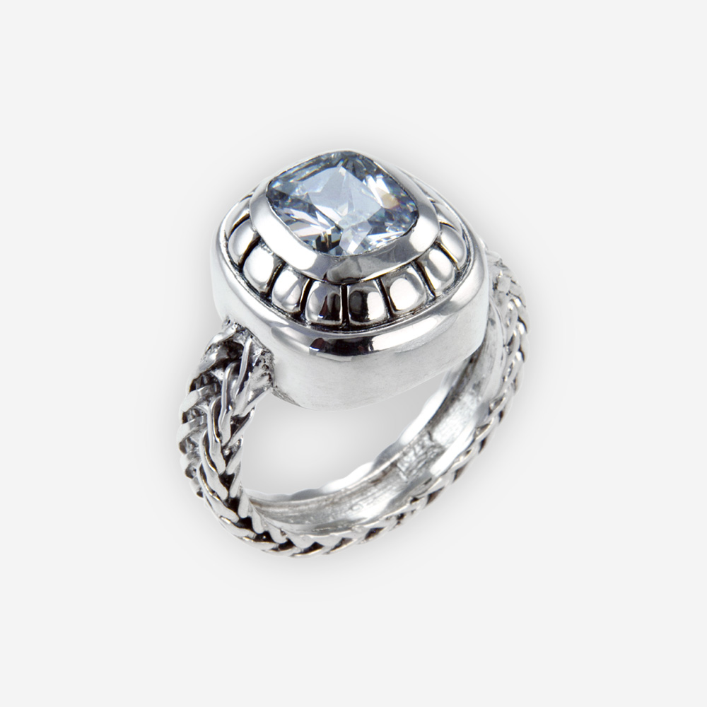 The Silver and Cubic Zirconia Ring, in sterling silver with blue cubic zirconia and chain body.