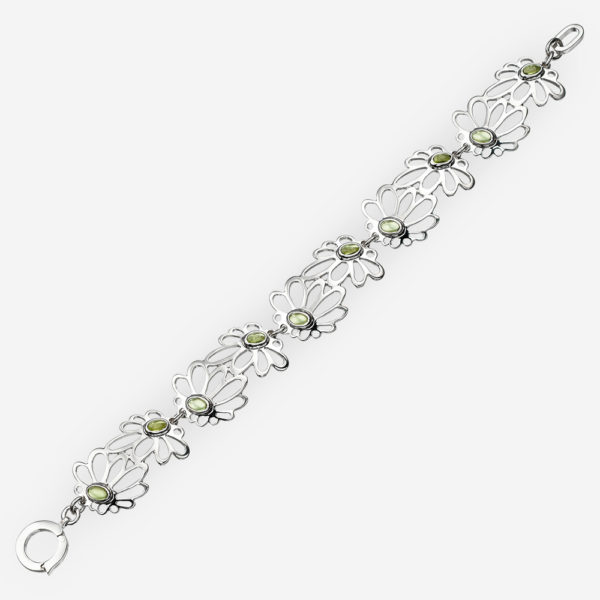 Silver daisy bracelet with sterling silver daisy flower links and peridot gems.