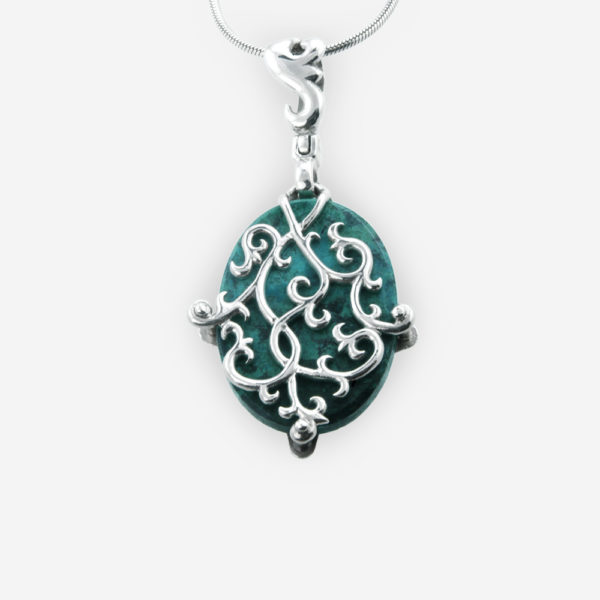 Silver filigree gemstone cabochon pendant is crafted from a 925 sterling silver piece overlaying a gemstone cabochon.