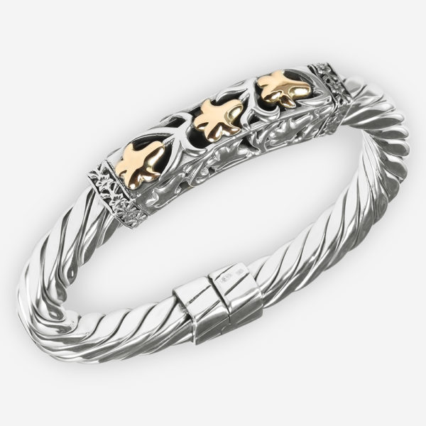 Sterling silver floral bangle with a twisted cable base and a two tone open filigree floral motif with three 14k gold lilies.