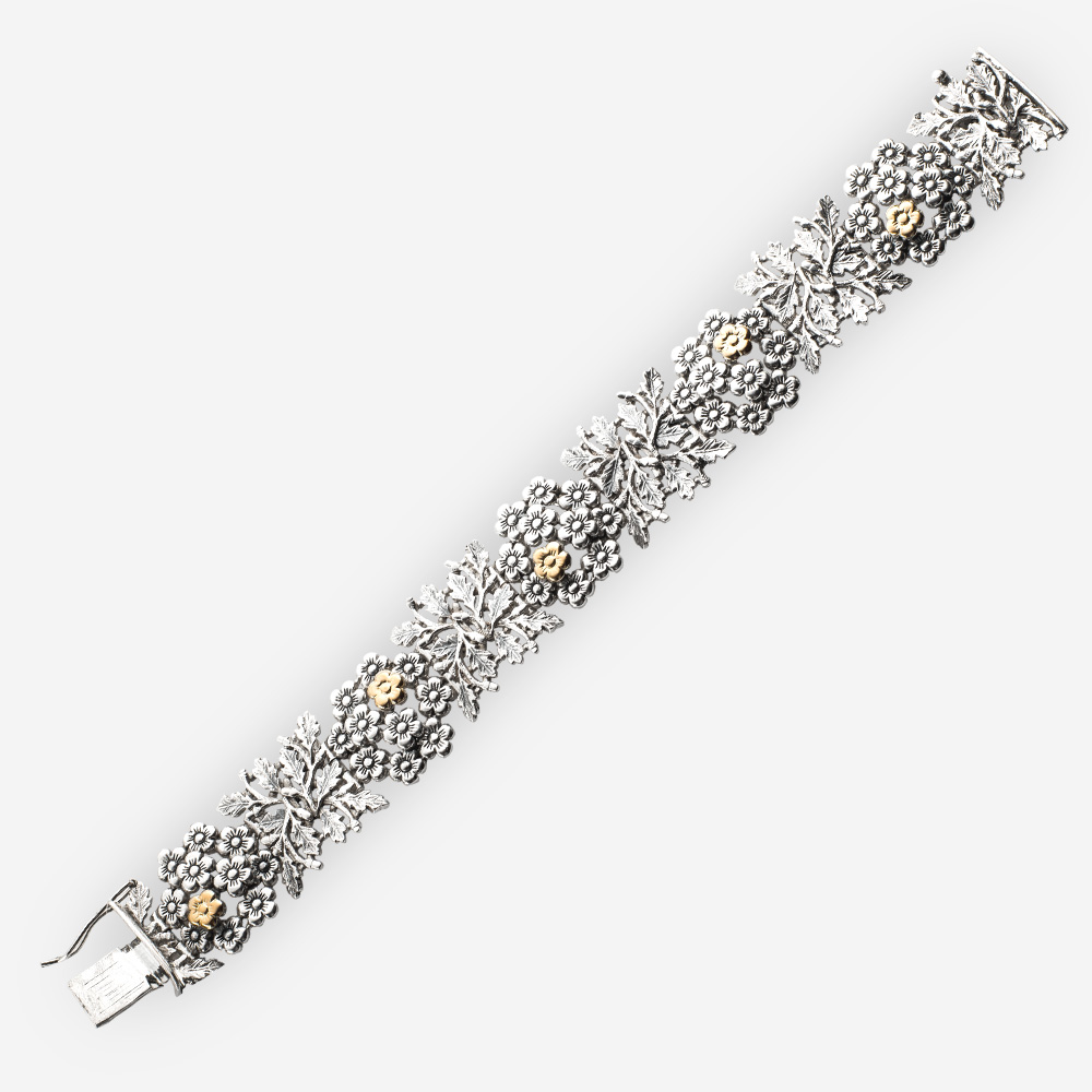 Silver flower bracelet with 14k gold flower accents.