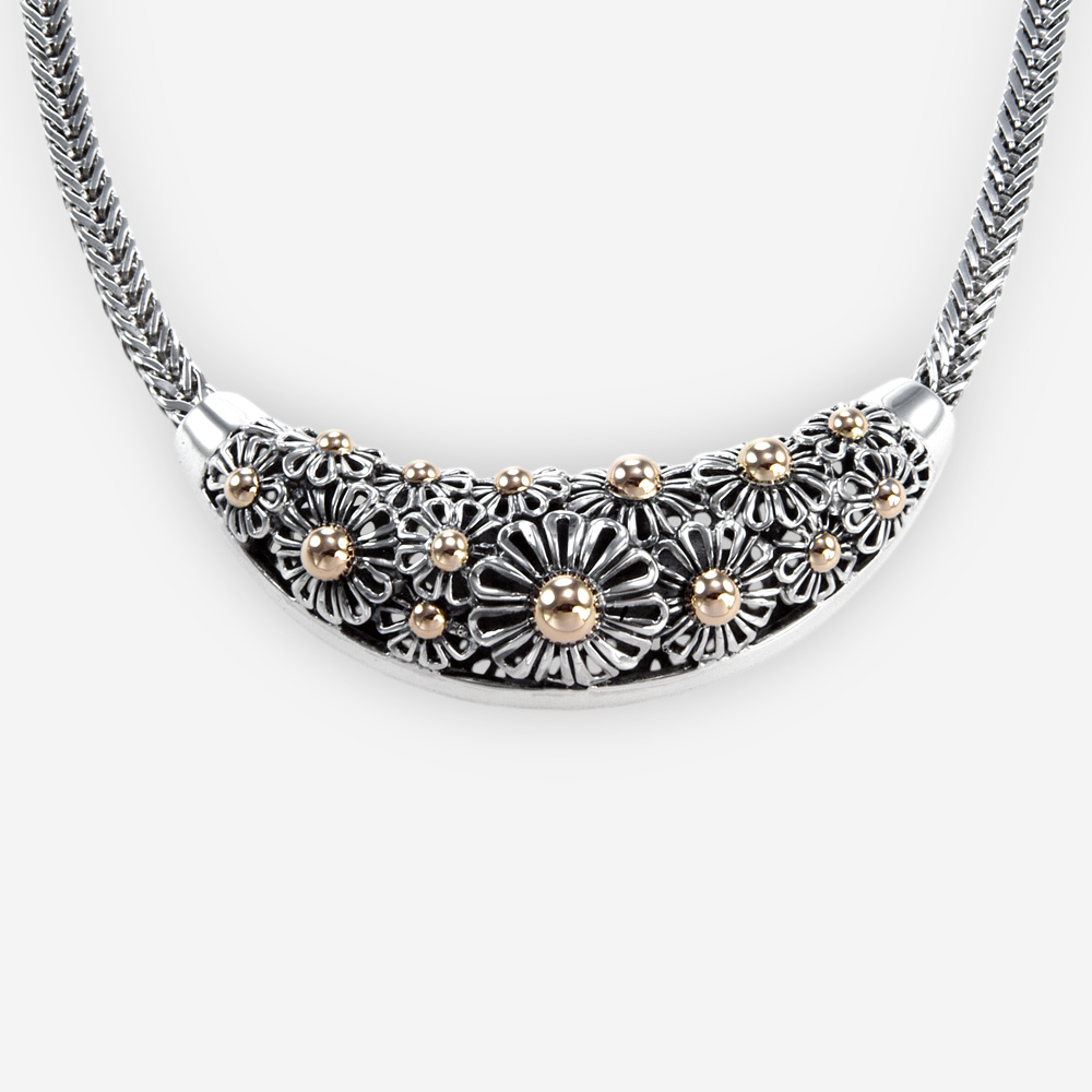 The Silver and Gold Daisies Necklace, in sterling silver with gold centered daisies and franco chain.