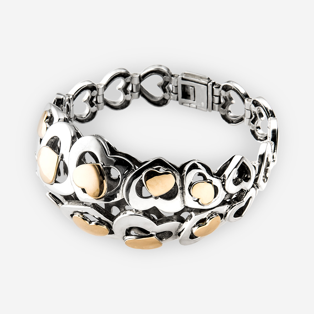 Silver and Gold Hearts Bracelet designed with different sized heart shapes in sterling silver and also gold.