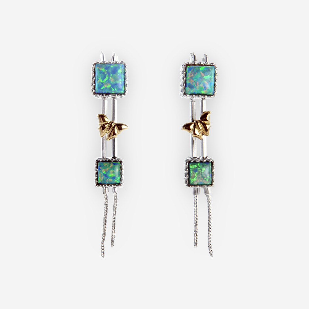 The Silver and Gold Opal Long Earrings, are crafted in sterling silver, opals and gold details.