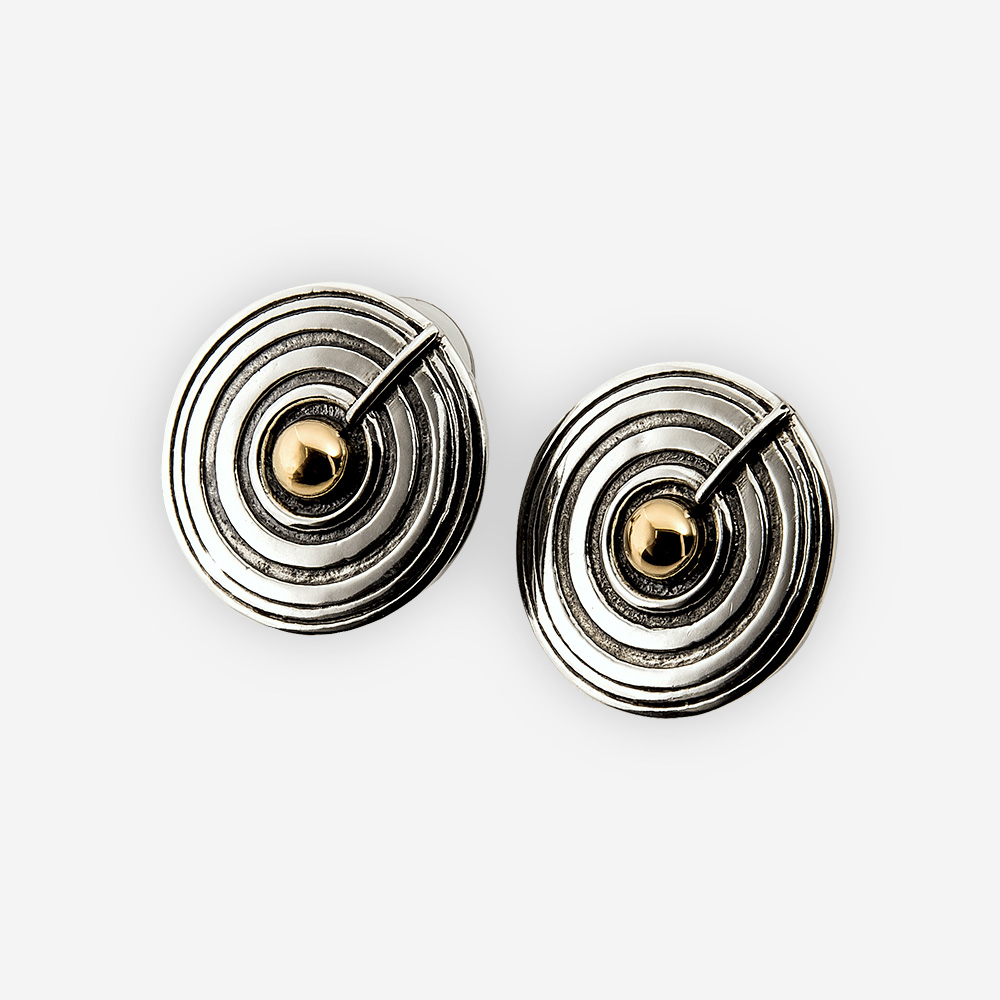 The Silver and Gold Round Stud Earrings, are crafted in sterling silver and a gold dot in the middle