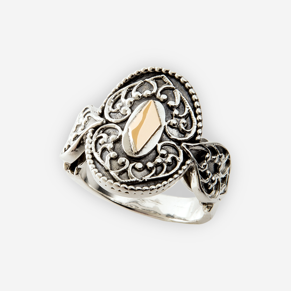 The Silver and Gold Yemenite Ring, in sterling silver with gold details. Also features a yemenite carved motif