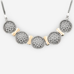 Silver lattice medallion necklace is crafted from 925 sterling silver and 14k gold on a silver chain.