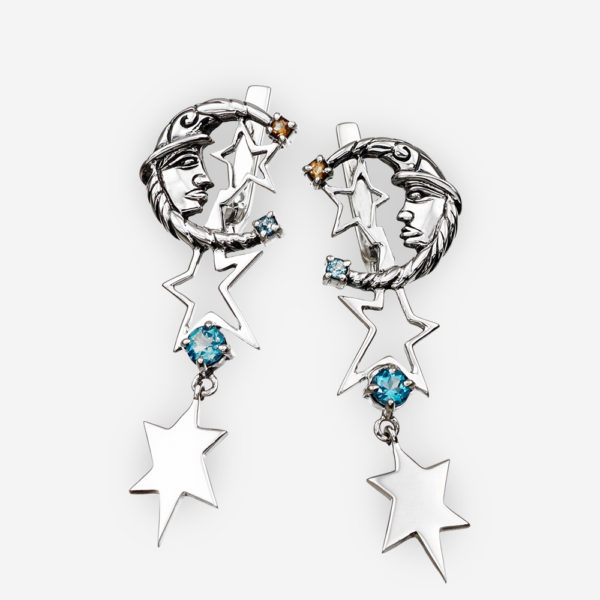 Silver lunar drop earrings with moon and star details as well as blue topaz and citrine gemstones.