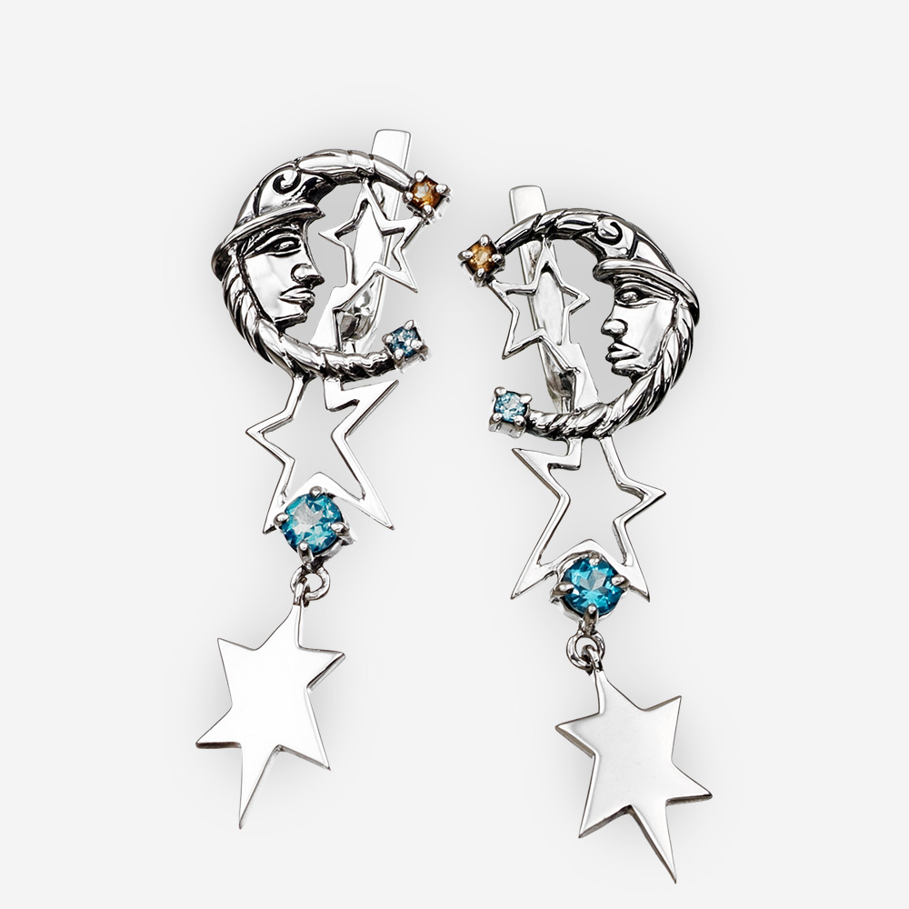 Aretes de plata con figuras de luna, estrellas, y con gemas de topacio azul y citrina.