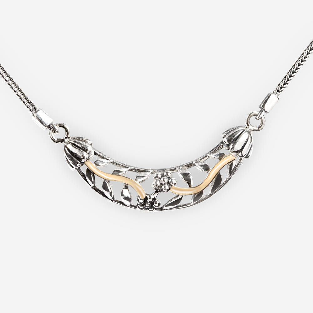 Silver openwork floral collar necklace crafted from 925 sterling silver with 14k gold accents.