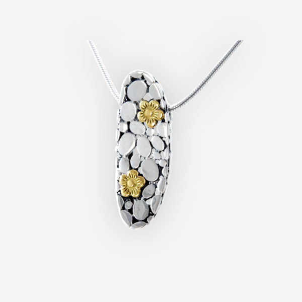 Oxidized silver pebbled necklace crafted from 925 sterling silver and 14k gold floral accents.