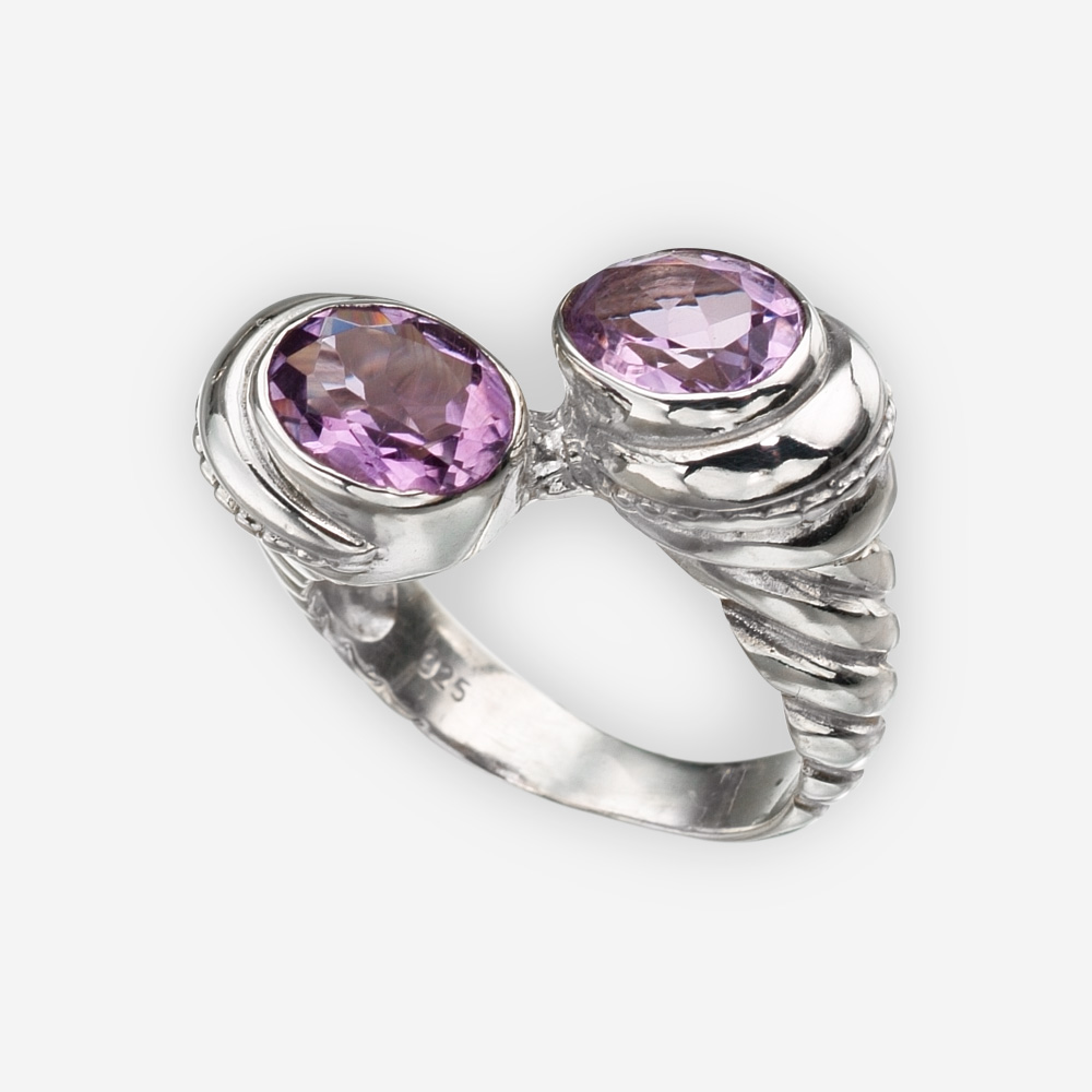 Silver sculpted twist ring is crafted from 925 sterling silver and feature two faceted gemstones on either end.