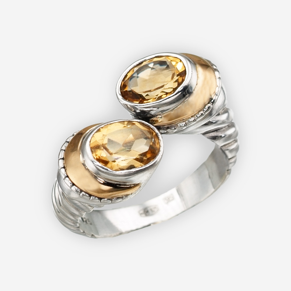 Silver sculpted twist ring is crafted from 925 sterling silver, 14k gold, and has two gemstones on either end.