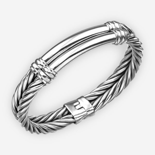 Silver twisted cable bangle with plain silver centerpiece and hinge closure.
