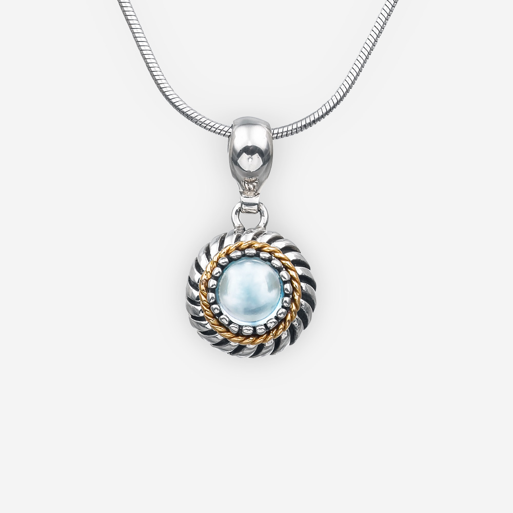 Silver twisted cable pendant crafted in 925 sterling silver, 14k gold, and a small round gem cabochon.
