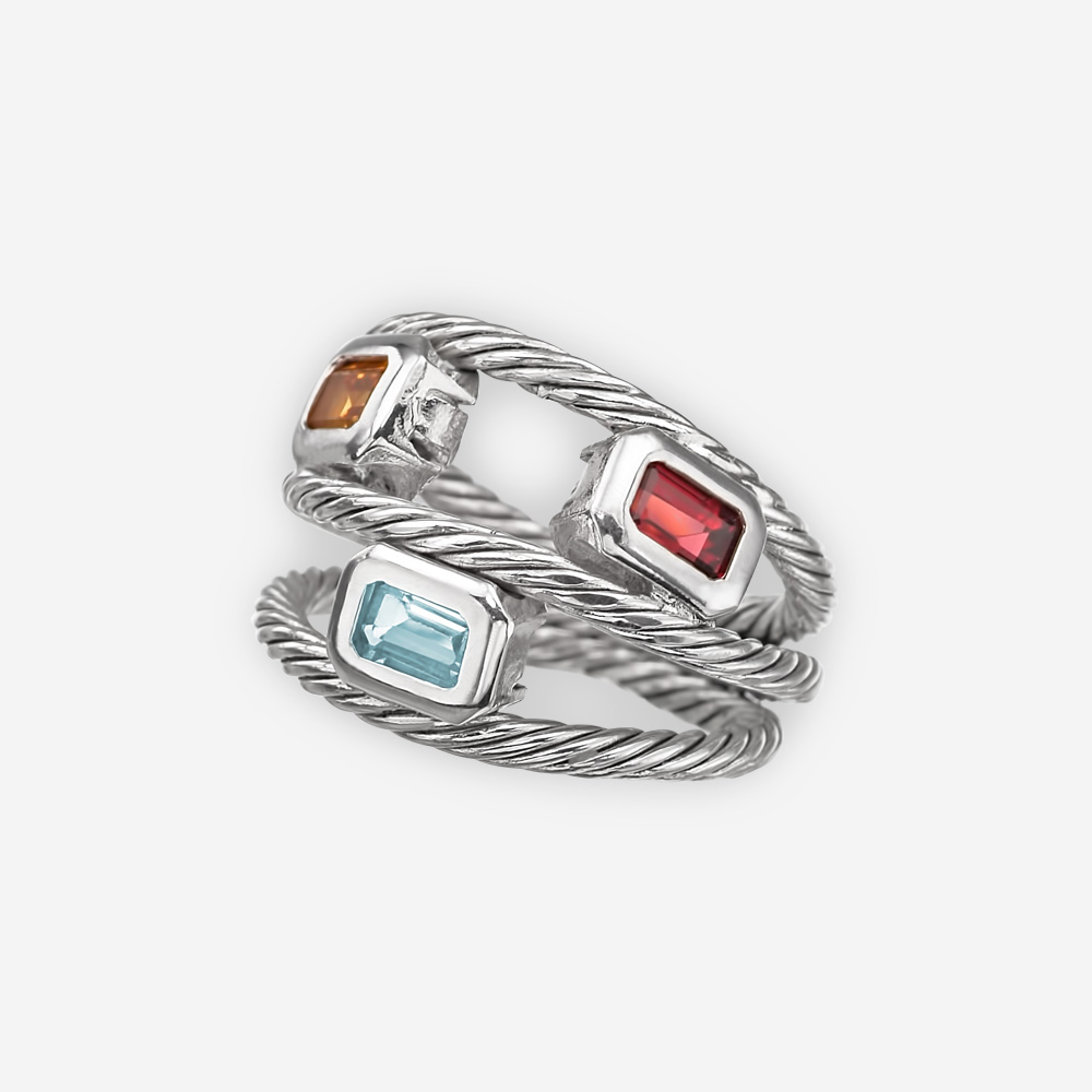 Silver twisted cable ring with garnet, blue topaz, and citrine gemstones on a triple layer band.