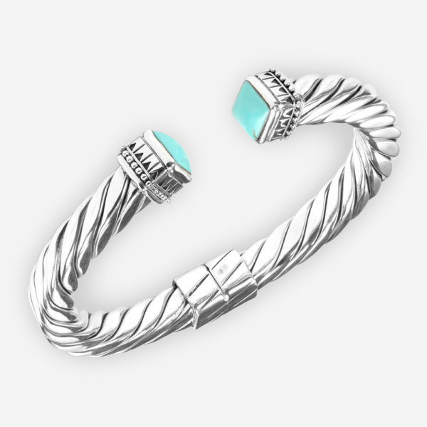 Thick silver twisted cable bracelet that features a single turquoise cabochon set at each end.