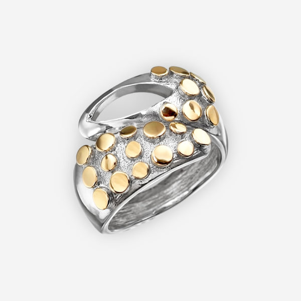 Sterling silver two tone statement ring with cutout design.