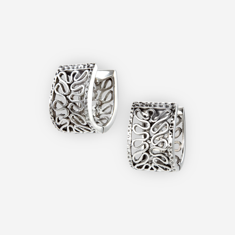 The Silver Weave Huggie Earrings are crafted in sterling silver.
