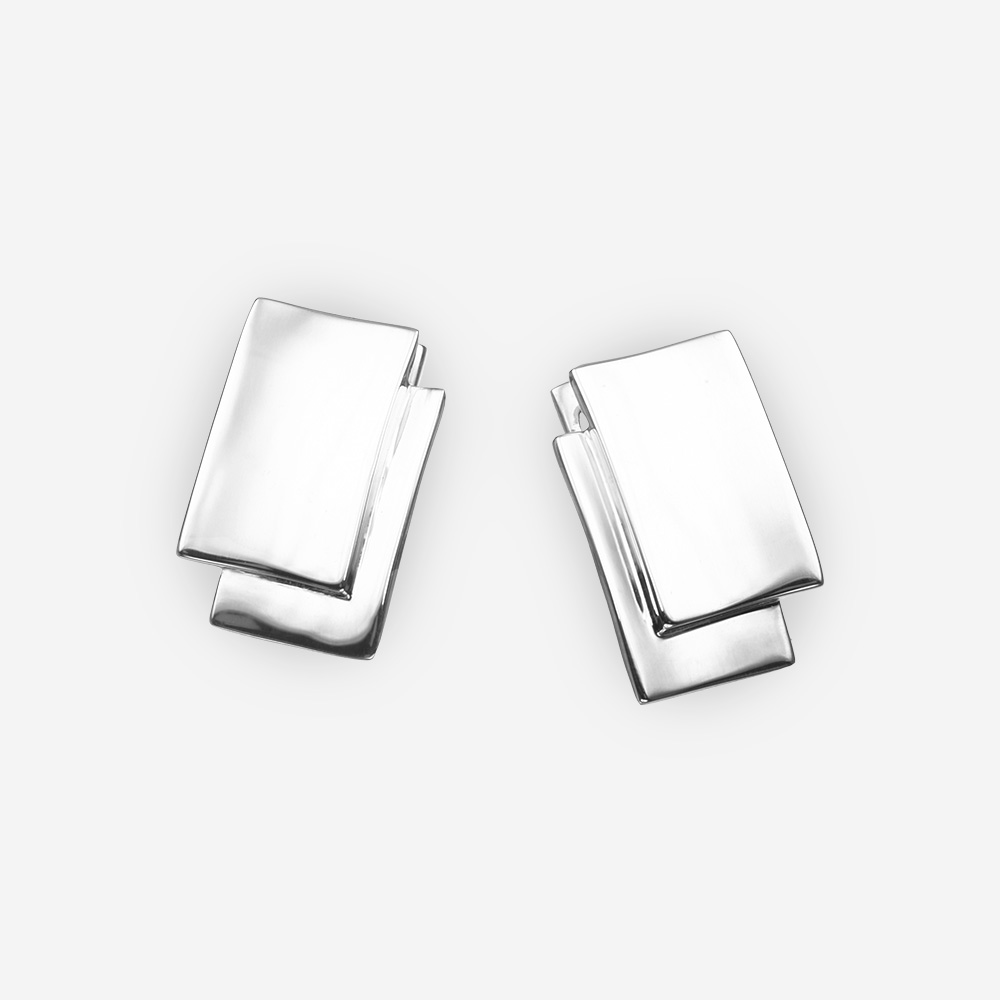 Sleek minimalist sterling silver earrings with overlapping details and high polished finish.