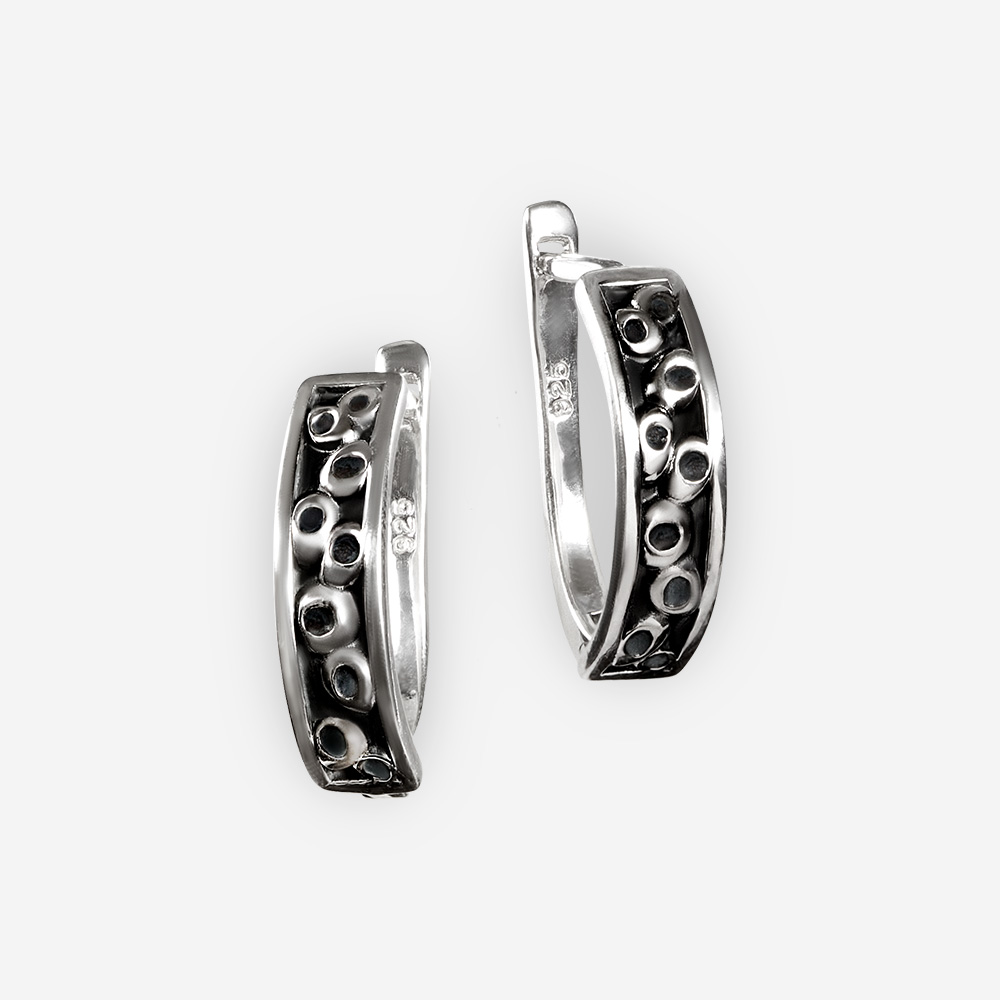 Small blackened sterling silver earrings with embossed circle pattern.