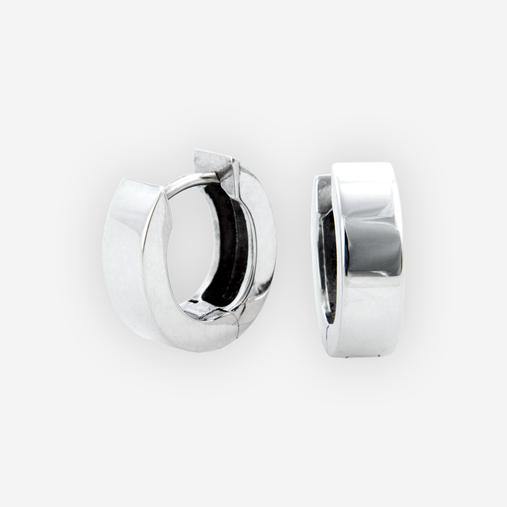 Small oval hinged hoops are crafted in 925 sterling silver with a polished finish.