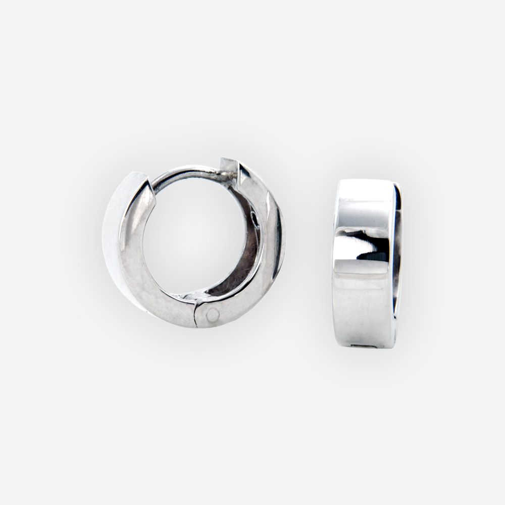 Small round hinged hoops crafted in 925 sterling silver with huggie closures