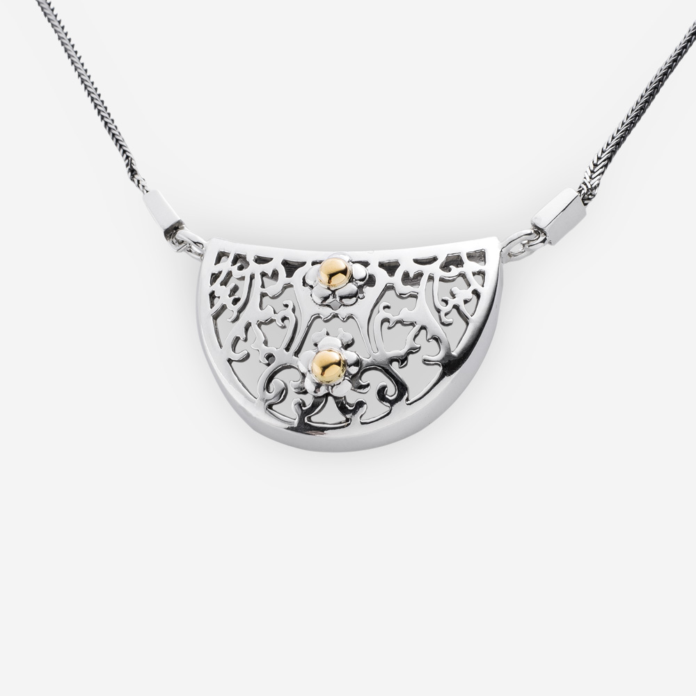 Small silver openwork necklace crafted in 925 sterling silver and 14k gold floral accents.
